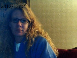 This is me tonight, back in my comfy clothes, hair un-brushed, face-paint removed, and gearing up for another try at this professional dress-up crap tomorrow.