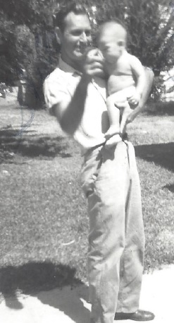 My grandfather holding my dad.